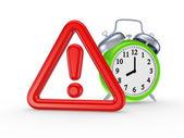 červený výstražný symbol a zelené hodinky. — Stock fotografie