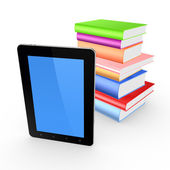 Tablet PC and stack of books. — Stock Photo