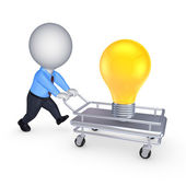 3d person with pushcart and yellow lamp. — Stock Photo