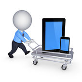 Tablet PC and cellphone on pushcart. — Stock Photo