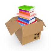 Colorful books in a carton box. — Stock Photo