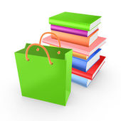 Stack of colorful books and green packet. — Stock Photo