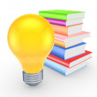 Colorful books and yellow lamp. — Stock Photo
