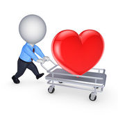 3d person with red heart on pushcart. — Stock Photo