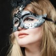 Girl in a mask — Stock Photo