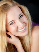 Portrait of the long-haired blonde with a white teeth smile — Stock Photo