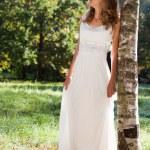 Beautiful bride in green sunny nature — Stock Photo