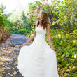 Elegant bride in white dress in autumn sunny nature — Stock Photo