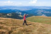 Woman tourist welcome gesture hands a hiking to the mountains — Stock Photo