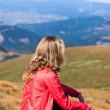 Stock Photo: Hiker womsitting on halt in mountains