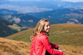 Young hiker woman portrait with copy space in the mountains — Stock Photo