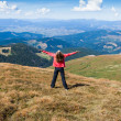 Stock Photo: Tourist on mountain with raised hands embracing vitality freedom