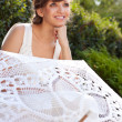 Portrait of beautiful greek woman bride in sunny nature - Stock Photo