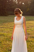 Beautiful laughing bride in the sunny nature — Stock Photo
