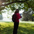 Постер, плакат: Woman backpacker read the map among the morning nature