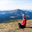 Stock Photo: Young hiker womsitting on halt in mountains