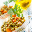 Salad vegetarian with canned green peas and boiled vegetables - Stock Photo