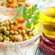 Salad with canned green peas and boiled carrots — Stock Photo