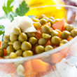 Salad with boiled carrots and canned green peas close up — Stock Photo
