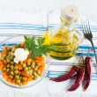 Salad with canned peas and boiled carrots. Oil and hot peppers — Stock Photo #16364429