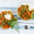 Salad with canned peas and boiled carrots on handmade fabric — Stock Photo