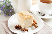 Cake Napoleon close-up, cinnamon and anise with a cup of tea — Stock Photo