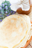 Fresh pancakes with honey on a plate — Stock Photo