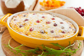 Cheese casserole with cranberries and raisins in dish — Stock Photo