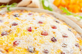 Cheese casserole with cranberries and raisins close-up — Stock Photo