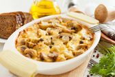 Vegetables casserole with mushrooms, potatoes and cheese closeup — Stock Photo