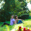 Beautiful couple in the summer park - Stock Photo