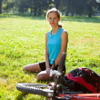 Stock Photo: Womcyclist enjoying relax in spring park