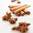 Pile of cinnamon sticks and cloves — Stock Photo