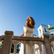 Young girl bride in a white dress in ancient city near the templ — Stock Photo