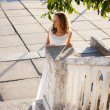 Young girl bride in the sunny old city in the morning — Stock Photo
