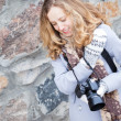 Stock Photo: Beautiful girl press photographer or tourist with a camera