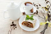 Still-life with freshly baked apple pie, tea and dry branch — Stock Photo
