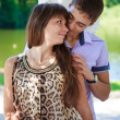 In love couple flirtation in a summer sunny park — Stock Photo