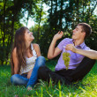 Stock Photo: Cheerful couple flirting and fooling around in a summer park