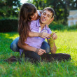 Happy cheerful couple fooling around in a summer sunny park — Stock Photo #21210743