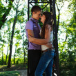 Loving couple embracing in summer sunny park — Stock Photo #21210861