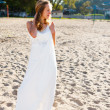 Girl bride in a white dress on the sunny beach — Stock Photo