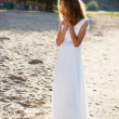 Dear girl bride  in a white dress on the sunny outdoor — Stock Photo