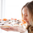 Beautiful girl with pizza. Enjoy the smell of freshly cooked pizza — Stock Photo