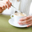 Closeup of cup coffee and woman hands. Girl on a coffee-break — Stock Photo