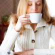 Coffee. Beautiful girl drinking coffee. Cup of hot beverage — Stock Photo