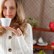 Beautiful girl with a cup of coffee in hand — Stock Photo