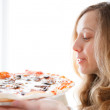 Beautiful young woman with pizza in hands — Stock Photo