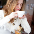 Young beautiful elegant girl drinking coffee or tea — Stock Photo