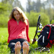 Girl cyclist barefoot enjoying relaxation — Stock Photo #24897681